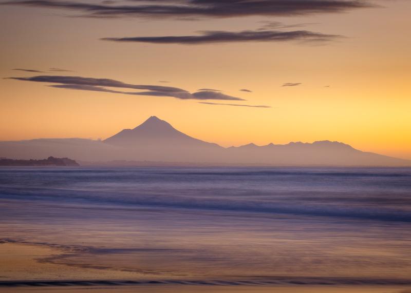 Mount Taranaki sunset over the sea.