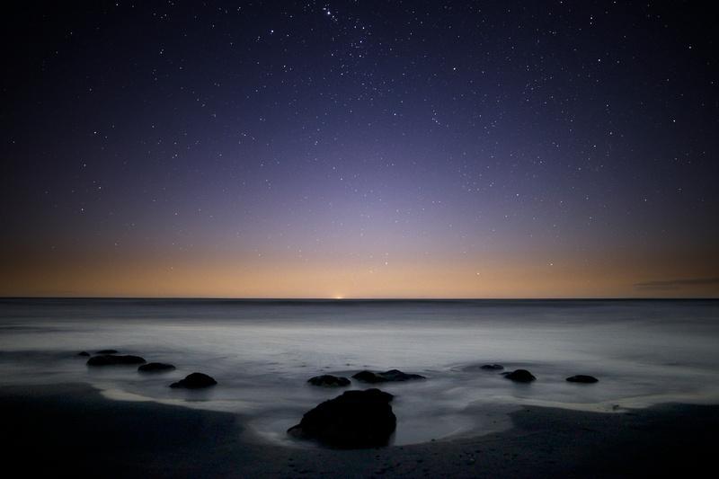 Dusk with stars and rocks at Tongaporutu.
